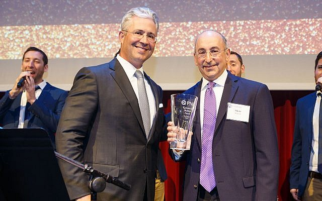 Steve Halpern, right, accepts the PNC Community Builders Award on behalf of his family. It was presented by Louis R. Cestello, left, of PNC Bank. (Photo by David Bachman)