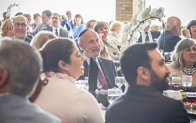 Rabbi Mark Joel Mahler and congregants enjoying a celebration of Rabbi Mahler's 38 years at Temple Emanuel as he prepares to retire. (Photo courtesy of Temple Emanuel)