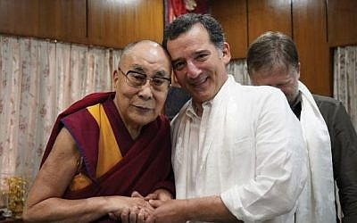 The author with the Dalai Lama: Hands across faiths. (Photo courtesy of the Office of the Dalai Lama)