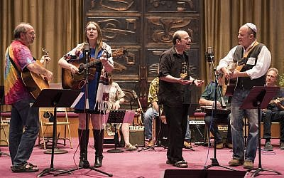 From left: John Schiller, Rabbi Keren Gorban, Doug Schiller and Ben Wecht. (Photo courtesy of Temple Sinai)