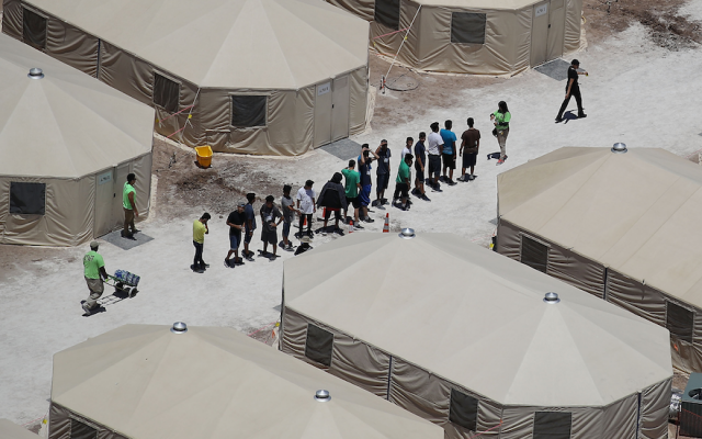 Children and workers at a tent encampment recently built near the Tornillo Port of Entry in Tornillo, Texas, June 19, 2018. (Photo by Joe Raedle/Getty Images)