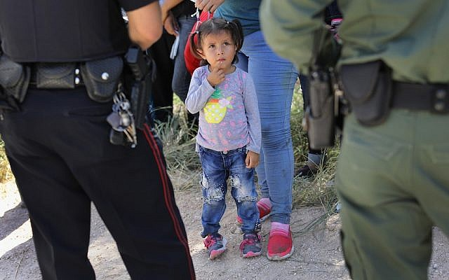 Officers taking a group of Central American asylum seekers into custody near McAllen, Texas, June 12, 2018. (Photo by John Moore/Getty Images)