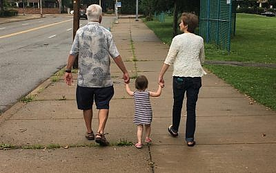 Betty Jo and Howard Louik walk with one of their granddaughters. (Photo courtesy of Betty Jo Hirschfield Louik)