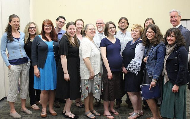 From left, back row: Kim Salzman, Marisa Tate, Alex Zisman, Elina Lipov, Bill Stein, David Guzikowski, Aviva Lubowsky, Rabbi Danny Schiff; front row: Lauren Wolcott, Rachel Lipkin, Debbie Swartz, Kate Kim, Hope Nearwood, Jennifer Slattery, Danielle Kranjec. (Photo courtesy of Jewish Federation of Greater Pittsburgh)