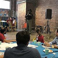 Richard Garland, director of the Violence Prevention Initiative, a local nonprofit based at the University of Pittsburgh, speaks to attendance members at Monday's gun violence community roundtable event at Repair the World Pittsburgh. (Photo by  Sara Tyberg)