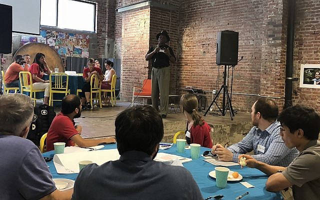 Richard Garland, director of the Violence Prevention Initiative, a local nonprofit based at the University of Pittsburgh, speaks to attendance members at Monday's gun violence community roundtable event at Repair the World Pittsburgh. (Photo by Jonah Berger)