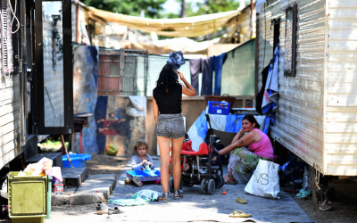 Members of the Roma community are pictured at a Roma camp on the outskirts of Rome, June 19, 2018. (Photo by Alberto Pizzoli/AFP/Getty Images)