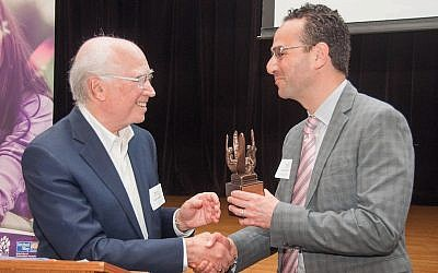 Bob Whitehill presenting JFCS Board Chair Dr. Matthew A. Keller with the Shore-Whitehill Award for outstanding leadership in the cause of inclusion and disability rights. (Photo by Adam Flanagan)