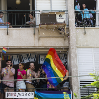 Revelers take part in the annual Pride Parade in Tel Aviv, June 8, 2018. (Photo by Amir Levy/Getty Images)