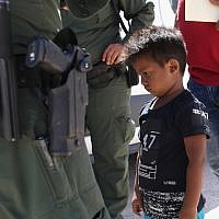 A boy from Honduras is shown being taken into custody by U.S. Border Patrol agents near the U.S.-Mexico Border near Mission, Texas, June 12, 2018. (Photo by John Moore/Getty Images)