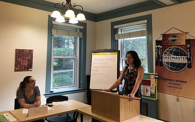 Daria Katson gives a speech on coaching skills during a Woman 2 Woman Toastmasters meeting. (Photo by Lauren Rosenblatt)