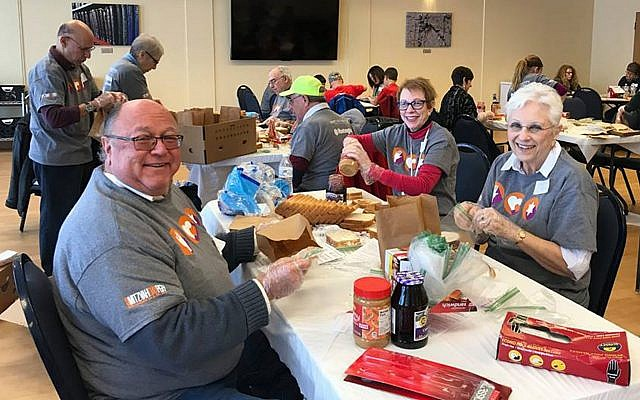 Volunteers from the South Hills Jewish community prepare food for SHIM's food pantries on Mitzvah Day. (Photo courtesy of the Jewish Federation of Greater Pittsburgh)