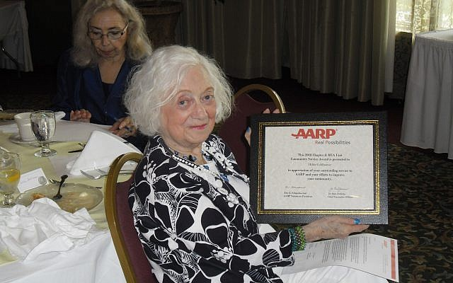 Hilda Golhamer is pictured receiving an AARP award. (Photo by Barry Werber)