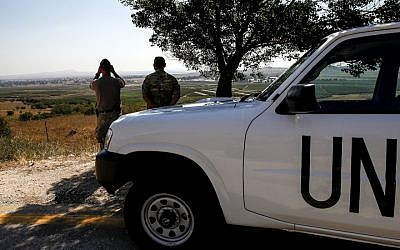 U.N. peacekeepers looking out towards Syria from the Israeli-annexed Golan Heights, July 22, 2018. (Photo by Jalaa Marey/AFP/Getty Images)