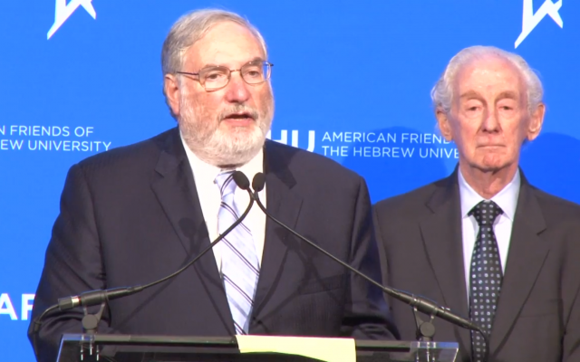 Meyer Koplow, left, accepts an award from the American Friends of The Hebrew University in 2016. (Photo screenshot from YouTube)
