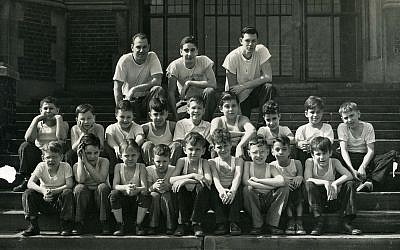 Members of the Woodbine Boys Club pose on the steps of Colfax Elementary School in March 1948, where they met for swimming, horseplay and other good times.	(Photo by Mervin S. Stewart, courtesy of Rauh Jewish History Program & Archives at the Sen. John Heinz History Center)