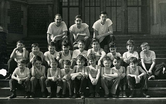 Members of the Woodbine Boys Club pose on the steps of Colfax Elementary School in March 1948, where they met for swimming, horseplay and other good times.(Photo by Mervin S. Stewart, courtesy of Rauh Jewish History Program & Archives at the Sen. John Heinz History Center)