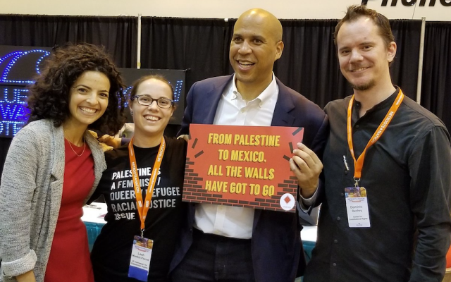 Sen. Cory Booker poses with attendees at the Netroots Nation 2018 conference in New Orleans.  (Photo by @US_Campaign/Twitter)