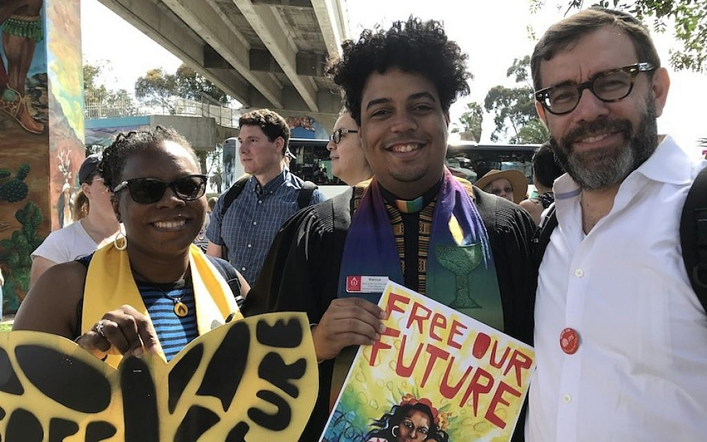 Rabbi David Hoffman of the Jewish Theological Seminary, right, and other participants at a San Diego rally  protesting the Trump administration's immigration policies organized by the grassroots group Mijente, July 2, 2018. (Photo courtesy of JTS Communications)