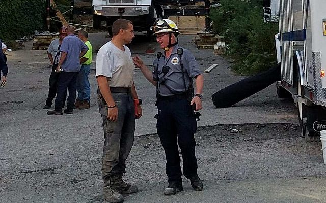 Last summer, Alan Hausman and members of PA Strike Team 1 spent nine hours rescuing a woman trapped in a collapsed apartment building in Washington County. (Photo courtesy of Alan Hausman)