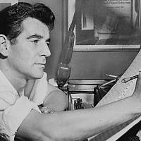 Leonard Bernstein seated at piano, making annotations to musical score in 1955. (Photo by Al Ravenna, World Telegram staff photographer, courtesy of Wikimedia Commons)