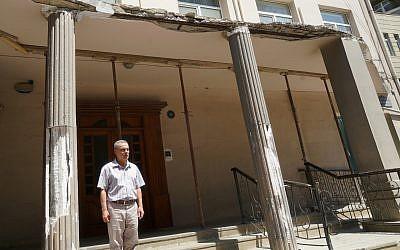 Saul Davidov greets regulars at the entrance to The Jewish House in  Baku, Azerbaijan. (Photo by Cnaan Liphshiz)