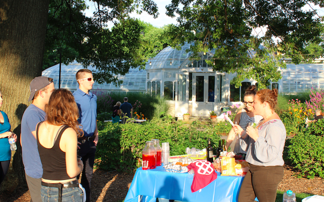 Attendees at the Shabbatluck picnic gathered for a Shabbat ritual around a table that included wine, candles and challah.(Photo courtesy of Jewish Federation of Greater Pittsburgh)