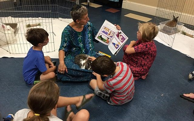 Rabbi Barbara Symons reads a story about caring for animals. (Photo courtesy of Temple David)