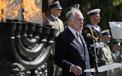 Ronald Lauder speaking next to a lit menorah at a memorial to the Warsaw Ghetto Uprising in Poland, April 19, 2018. (Photo by Sean Gallup/Getty Images)