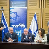 Prime Minister Benjamin Netanyahu, seated second from left, leads a Likud faction meeting in the Israeli parliament in Jerusalem in July. (Photo by Miriam Alster/Flash90)