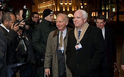 Sen. John McCain with Sen. Joseph  Lieberman at the Munich Security  Conference in Germany in 2014. (Photo by Joerg Koch/Getty Images)
