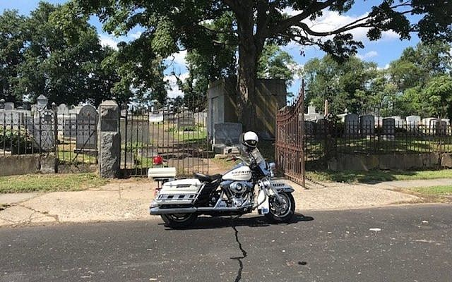 A police motorcycle outside the B'nai Abraham Cemetery in Newark, N.J. (Photo courtesy of Dov Ben-Shimon/Facebook)