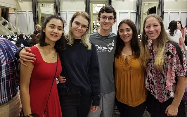 Students in the Pitt O'Hara Student Center Ballroom before Rosh Hashanah dinner. (Photo courtesy of Chabad House on Campus)