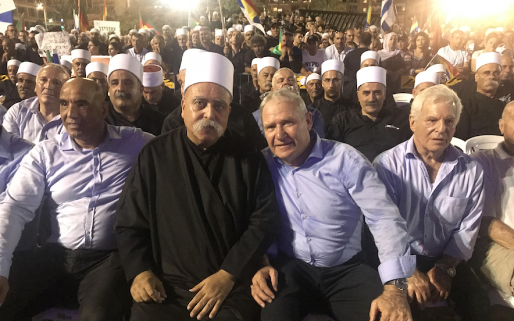 Amos Yadlin, third from left, sits with leaders of Israel's Druze community at a Tel Aviv rally against the controversial nation-state law, Aug. 5, 2018. (Photo courtesy of Amos Yadlin)