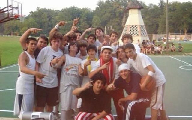 Malcolm McCormick (second row, first on the left) with his own cabin group at Emma Kaufmann Camp when he was a camper. (Photo courtesy of Emma Kaufmann Camp)