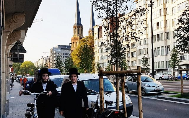 Two Jews walking down a street in Antwerp, Belgium, August 22, 2018. (Photo by Cnaan Liphshiz)