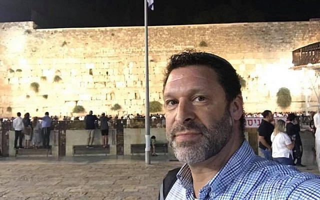 Ari Fuld, shown at the Western Wall in Jerusalem, worked at a nonprofit that provides food and supplies to Israeli soldiers. (Photo from Facebook)