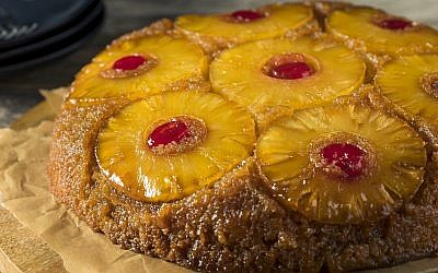 Pineapple upside down cake, a symbol of hospitality from the past. (Photo by bhofack/iStockphoto.com)