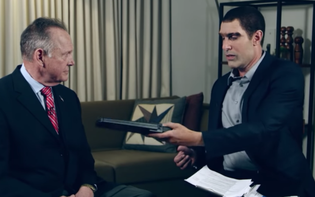 "Roy Moore, left, appearing on Sacha Baron Cohen's show ""Who is America?"" (Screenshot from YouTube)"