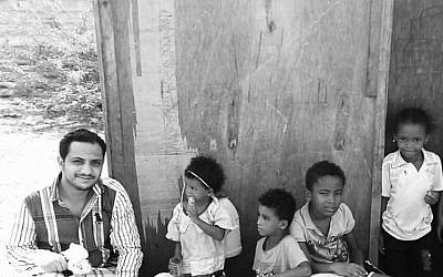 "Mohammed Al Samawi, author of ""The Fox Hunt,"" while working with World Relief. (Photo courtesy of Sharyn Rosenblum, Harper Collins)"