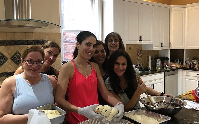 Front row from left: Amy Jaffe, Etti Martel, Cindy Vayonis; back row from left: Robin Simon, Jill Horvat and Sally Meyers are baking challah bread for the Jewish Sisterhood Oct. 23 event. Along with recipes from around the world, cookbook author Rochie Pinson will demonstrate bread braiding.   (Photo courtesy of Shternie Rosenfeld)