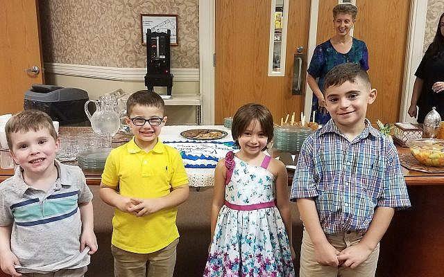 Mazel Tov to Temple David's newest students, Aaron DiCola, Asher Rose, Rory Pihony and Bentley Rose, who were consecrated during erev Simchas Torah-Shemini Atzeret services. (Photo courtesy of Temple David)