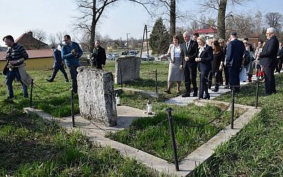 Photographers capture a ceremony at a Jewish cemetery in Frampol, Poland. (Photo by ESJF)