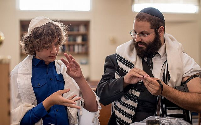 Rabbi Yehoshua Soudakoff, executive director of the Jewish Deaf Foundation (JDF) and director of Chabad of the Deaf Community in Israel, works with a student.(Photo courtesy of JDF)