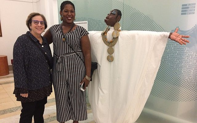 "Leslie Golomb (left), poses with sculptor Dominique Scaife and Scaife's piece, ""Serenity."" (Photo by Toby Tabachnick.)"