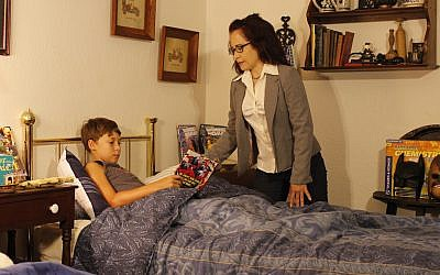 TV reporter Rosa Perez (Christina Santavicca) tucks her son (Aaron Grant) into bed in Episode 12.		(Photo courtesy of Heroineburgh)