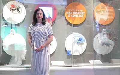 Milliner Jennifer Copeland stands alongside her creation at the Kentucky Derby Museum. (Photo by Benjamin Copeland)