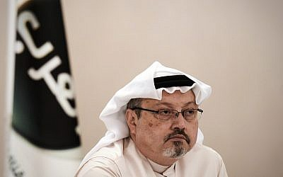 Jamal Khashoggi at a press conference in 2014.   (Photo by Mohammed Al-Shaikh/AFP/Getty Images)