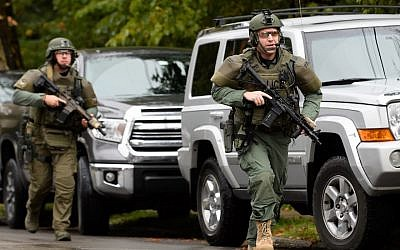 Police respond to a mass shooting at the Tree of Life Synagogue in the Squirrel Hill neighborhood of Pittsburgh, Oct. 27, 2018. (Photo by Jeff Swensen/Getty Images)