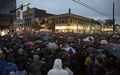 Members of the Squirrel Hill community in Pittsburgh come together for a student-organized candle vigil in remembrance of those who died earlier in the day during a shooting at the Tree of Life Synagogue, Oct. 27, 2018. (Photo by Dustin Franz/AFP/Getty Images)